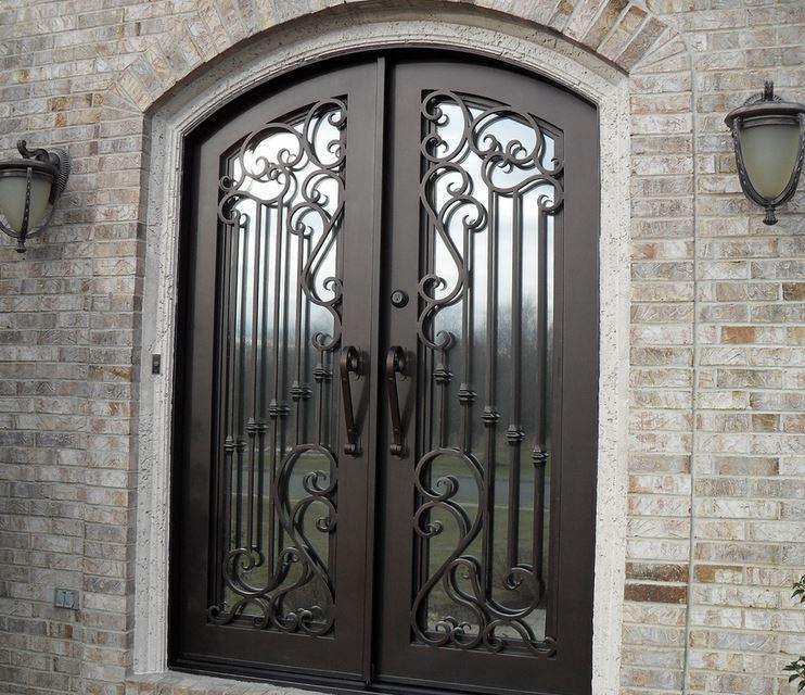 Puertas de forja en monterrey hierro metal aluminio for Puertas de madera con herreria