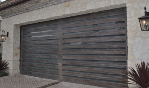 portones de acero acabado madera electricos y manuales